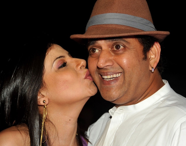 Indian Bollywood film actor Ravi Kishan (R) attends the '12.12.12' birthday celebration of Bollywood dancer and actress Sambhavna Seth (L) in Mumbai.