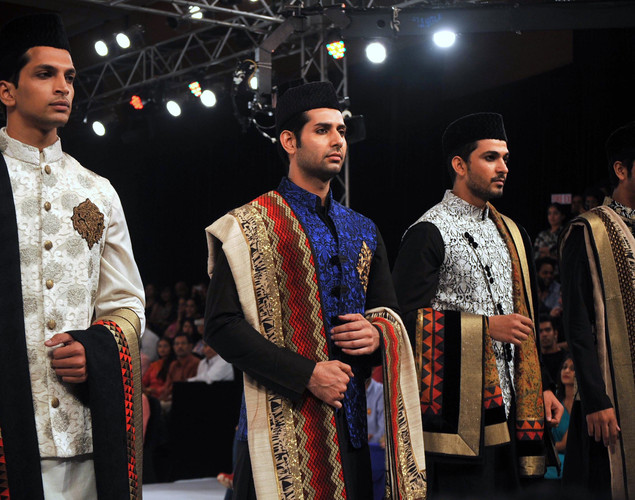 Indian models display creations by designer Vikram Phadnis at the 8th edition of Seagram's Blenders Pride Fashion Tour 2012 in Mumbai.