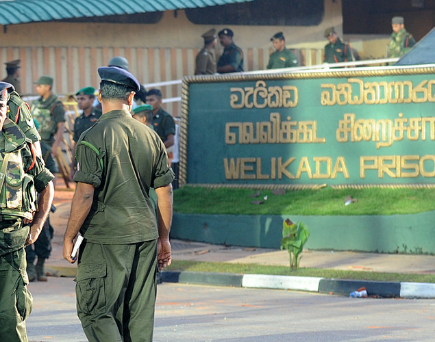 Sri Lankan soldiers stand guard near the Welika maximum prison in Colombo.