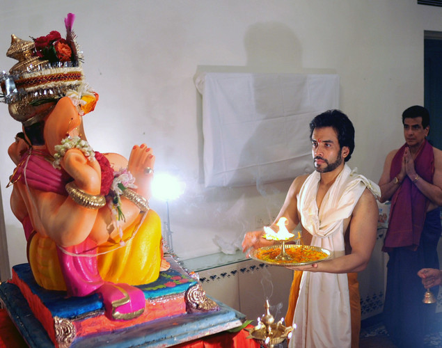 Indian Bollywood actor Tusshar Kapoor and his father Jeetendra offer prayers to an idol of Hindu God Lord Ganesh during the festival of 'Ganesh Chaturthi' in Mumbai.