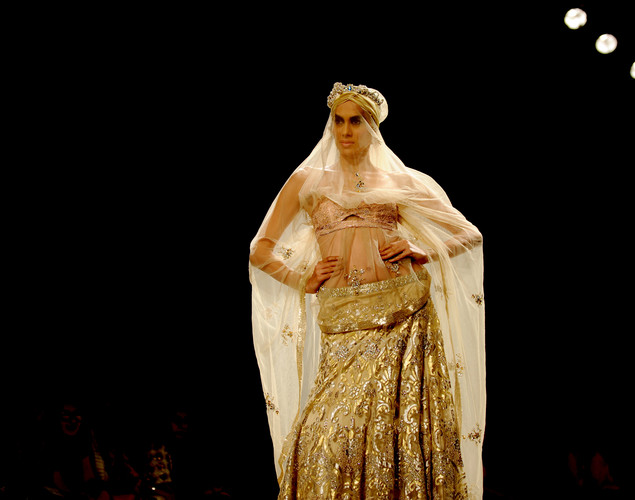 A model presents a creation by Indian designer Suneet Varma during the Wills India Fashion Week Spring- Summer collection 2013 in New Delhi.