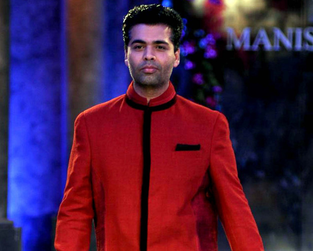 Karan Johar poses during a fashion show for The Mijwan Welfare Society in Mumbai late September 3, 2012.
