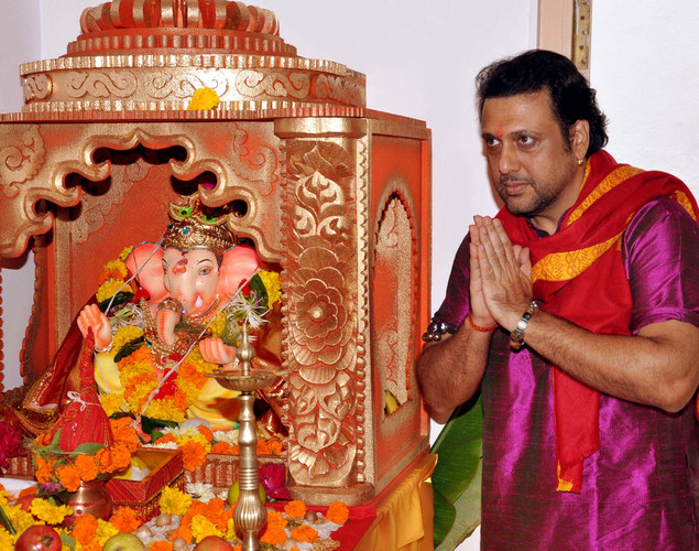 Indian Bollywood actor Govinda poses as he offers prayers to an idol of Hindu God Lord Ganesh during the festival of 'Ganesh Chaturthi' in Mumbai.