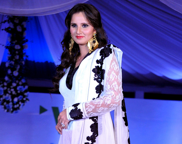 Indian tennis player Sania Mirza displays a creation by designer Neeta Lulla during a fashion show entitled Walk of  peace in Mumbai.