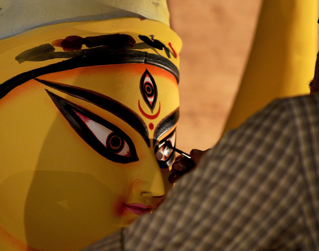 An artist paints the eyes of an idol of Hindu Godess Durga on the last day of 'Pitrupaksh' - days for offering prayers to ancestors - at a workshop in Mumbai.