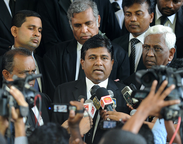 Sri Lankan lawyer Wijedasa Rajapakse (C) speaks with reporters outside the Sri Lankan Supreme Court in Colombo.