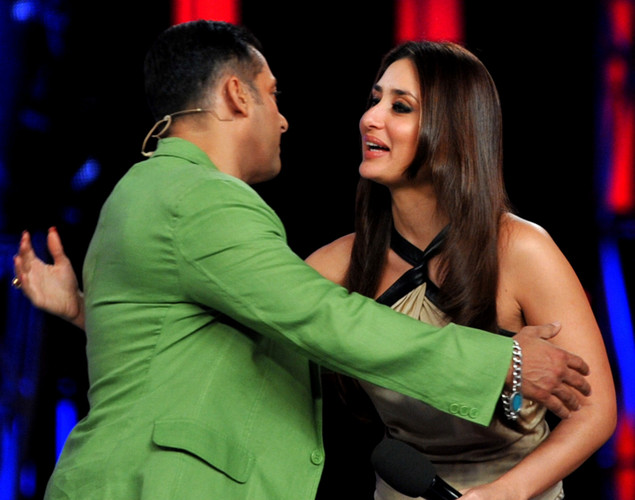 Bollywood actress Kareena Kapoor (R) performs a song with actor Salman Khan on the set of a television show during the promotion of their forthcoming Hindi film 'Dabbang 2' in Lonavala.