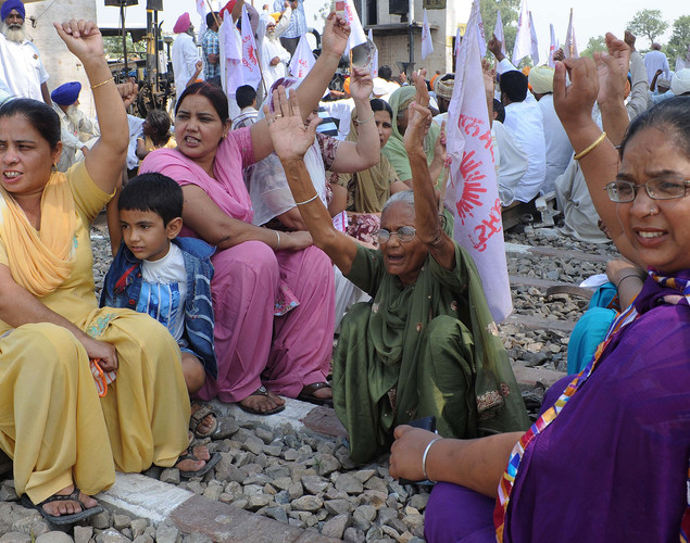 Indian farmers wives block railway tracks during a protest against the state and central government at Rayya village some 35 km from Amritsar.