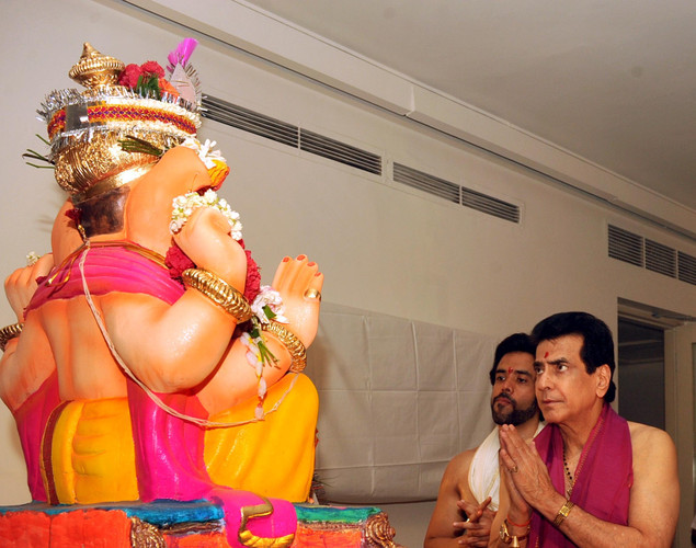 Indian Bollywood actor Jeetendra (R) with son Tusshar Kapoor offer prayers to an idol of Hindu God Lord Ganesh during the festival of 'Ganesh Chaturthi' in Mumbai.