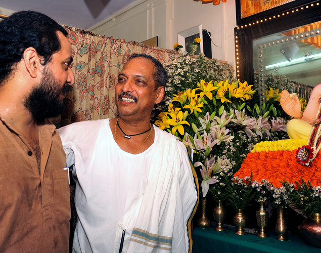 Indian Bollywood actor and filmmaker Vishwanath Nana Patekar (R) interacts with his son Malhar Patekar while posing in front of an idol of Hindu God Lord Ganesh during the festival of 'Ganesh Chaturthi' in Mumbai.