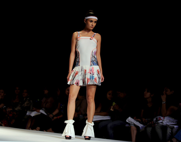 A model presents a creation by Indian designers Hemant and Nandita during the last day of the Wills India Fashion Week Spring- Summer collection 2013 in New Delhi.