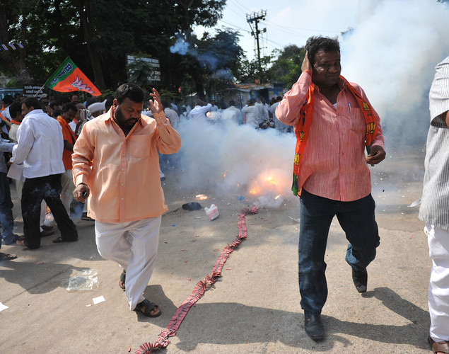Members of the opposition Bharatiya Janata Party(BJP) set off fire-crackers and distribute sweets as the celebrate the execution of Pakistan-born Mohammed Kasab, the sole surviving gunman of the 2008 Mumbai attacks, in Hyderabad.