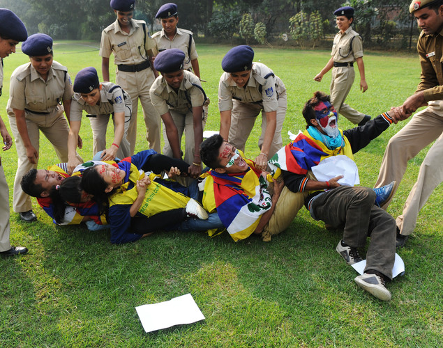 Indian police detain Tibetan activists shouting slogans during a protest near the Chinese embassy in New Delhi.