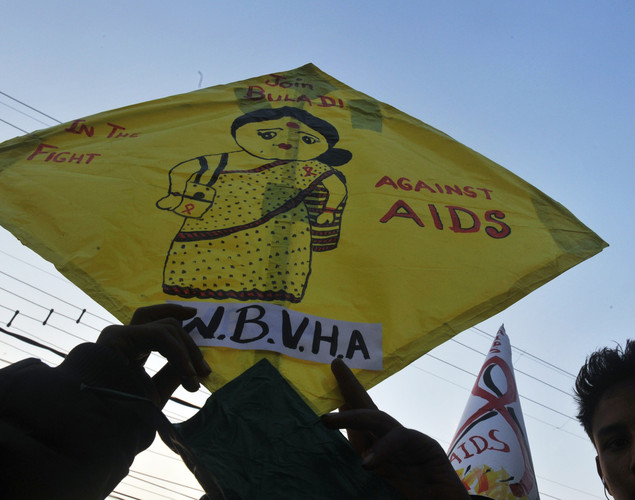 Indian volunteers and the members of the West Bengal Voluntary Health Association (WBVHA) holds kites with HIV/ AIDS awareness messages during rally in Siliguri.