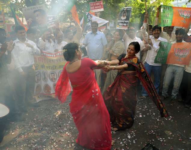 India's opposition Bharatiya Janata Party activists dance as they celebrate the execution of Pakistan-born Mohammed Kasab, who was the sole surviving gunman of the 2008 Mumbai attacks, in Mumbai.