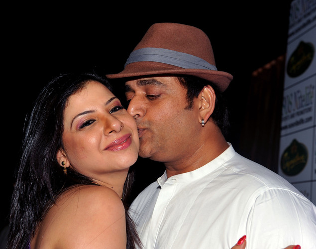 Indian Bollywood film actor Ravi Kishan (R) attends the '12.12.12' birthday celebration of dancer and actress Sambhavna Seth (L) in Mumbai.