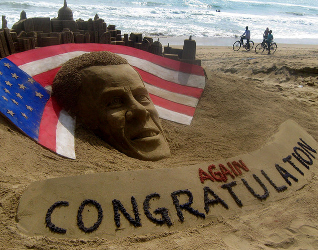 Cyclists look at a sand sculpture of re-elected US President Barack Obama by sand artist Sudarshan Pattnaik at Puri beach, about 70 kms east of the eastern city of Bhubaneswar.