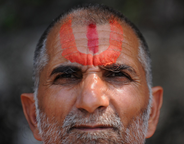 An Indian Hindu devotee looks on after performing 'Tarpan', a ritual to pay obesience to one's forefathers, on the last day for offering prayers to ancestors called 'Pitrupaksh' in Mumbai.