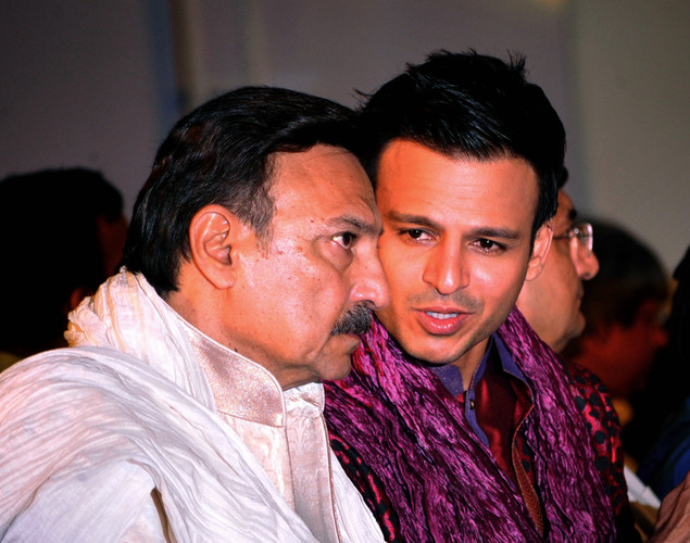 Indian Bollywood actors Vivek Oberoi (R) and his father Suresh Oberoi speak ahead of a fashion show entitled Walk of  peace in Mumbai.