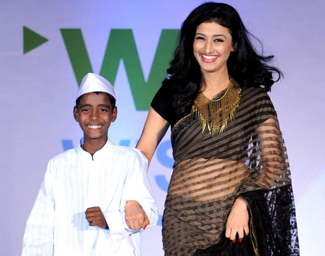 Indian television actress Ragini Khanna (R) displays a creation by designer Neeta Lulla during a fashion show entitled Walk of  peace in Mumbai.
