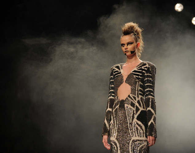 A model presents a creation by Indian designers Rohit Gandhi and Rahul Khanna, and Dutch designers Diederik Verbake and Marieke Holthuis during the Wills India Fashion Week Spring- Summer collection 2013 in New Delhi.