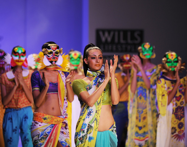Models present creations by Indian designer Nida Mahmood during the last day of the Wills India Fashion Week Spring- Summer collection 2013 in New Delhi.