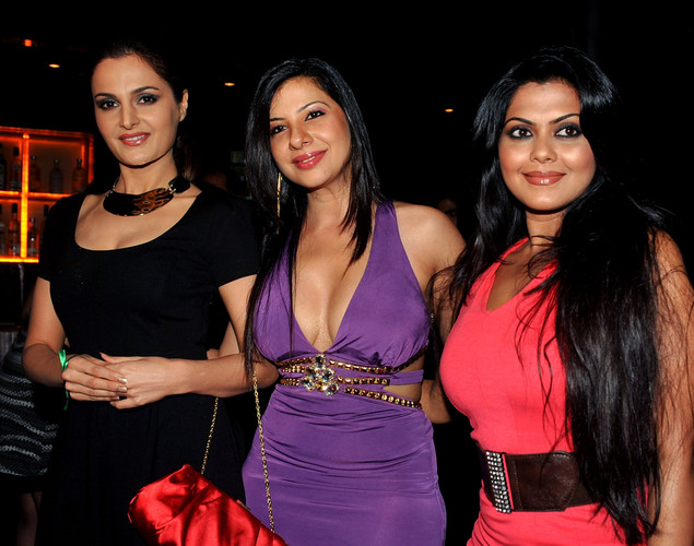 Indian Bollywood film actresses Monika Bedi (L) and Rinku Ghosh (R) attend the '12.12.12' birthday celebration of dancer and actress Sambhavna Seth (C) in Mumbai.