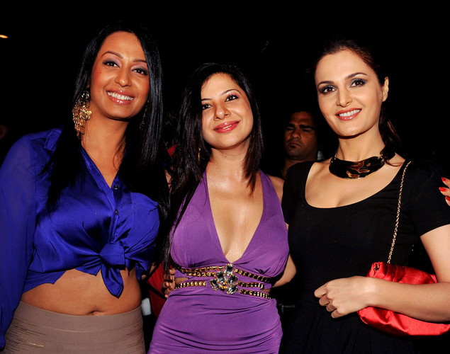 Indian Bollywood film actresses Kashmira Shah (L) and Monika Bedi (R) attend the '12.12.12' birthday celebration of dancer and actress Sambhavna Seth (C) in Mumbai.