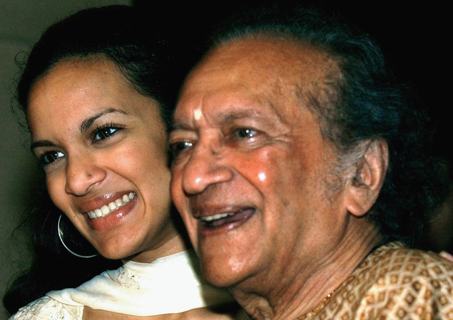 In this Dec. 19, 2002, Indian Sitar maestro Ravi Shankar, right, and daughter Anoushka Shankar smile during a press conference in Calcutta, India.