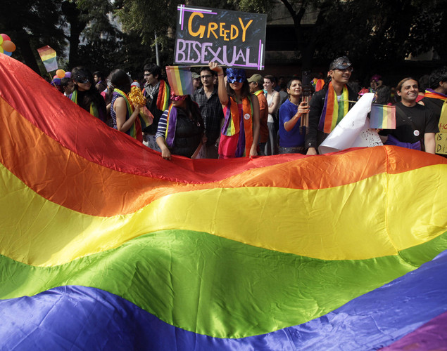 Demonstrators carry a nearly 50-foot-long, rainbow-colored banner at the 5th Delhi Queer Pride parade in New Delhi, India.