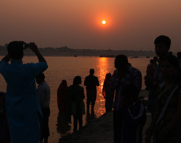 Hindu devotees perform religious rituals as they offer prayers to the Sun God at Sangam during Chhath festival in Allahabad.