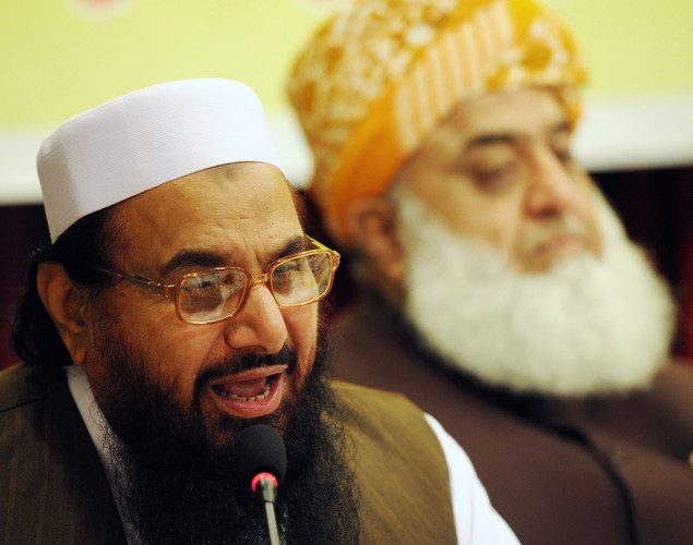Hafiz Mohammad Saeed (L), head of Pakistan's hard line Islamic group of Jamaat ud Dawa (JuD), addresses a conference for the 'safeguarding the honor of the Prophet Mohammad', as Maulana Fazalur Rehman, chief of religious Islamic party Jamiat-e- Ulema Islam (JUI) looks on in Islamabad.