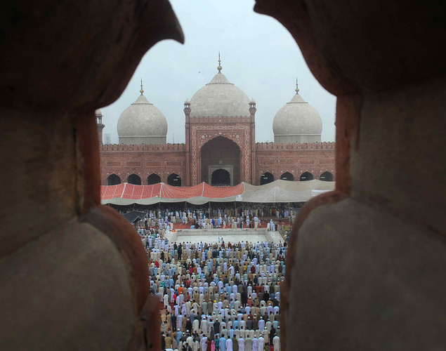 Pakistani Muslims offer Eid al-Fitr prayers at the Badshahi Masjid Mosque.