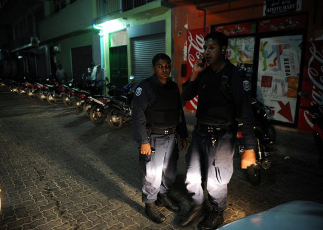 Maldivian security personnel man a check point in the capital Male