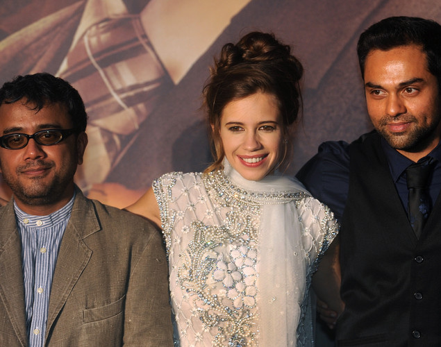 Bollywood actress Kalki Koechlin (C), actor Abhay Deol (R) and director Dibankar Banerjee pose for the media after arriving at the green carpet to attend the premier of their new movie 'Shanghai' during the International Indian Film Academy (IIFA) awards event, in Singapore.