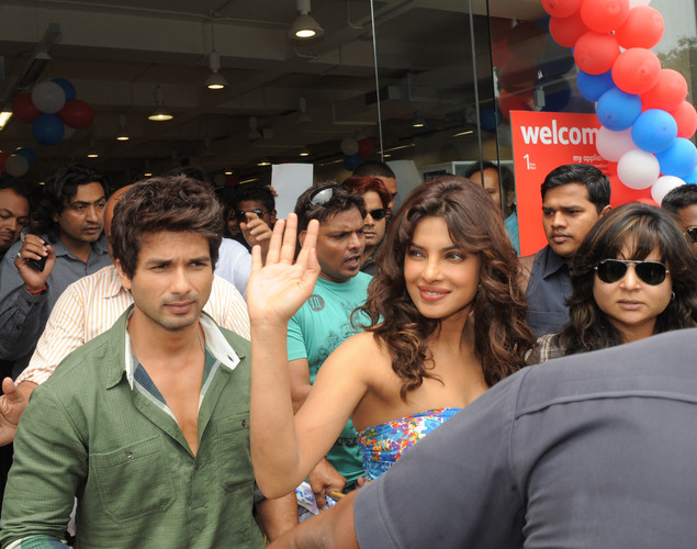 Bollywood actors Shahid Kapoor (L) and Priyanka Chopra leave a press conference about the upcoming film 'Teri Meri Kahaani', in Ahmedabad.