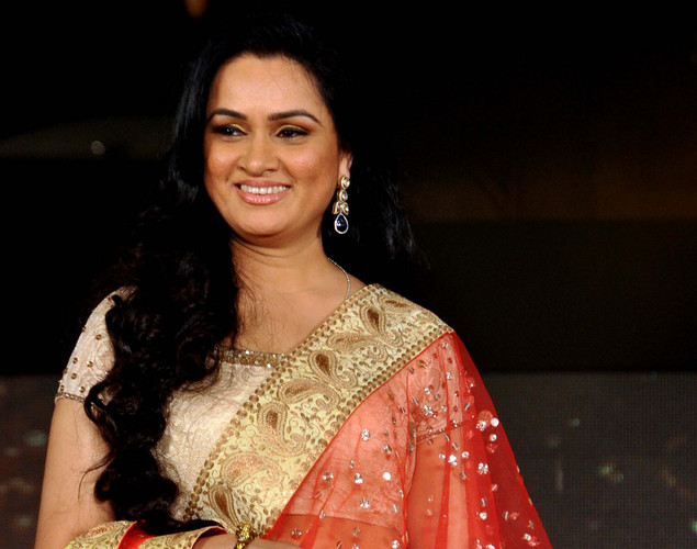 Padmini Kolhapure displays a creation by designer Manish Malhotra for a public awareness campaign Save and Empower the Girl Child in Mumbai.