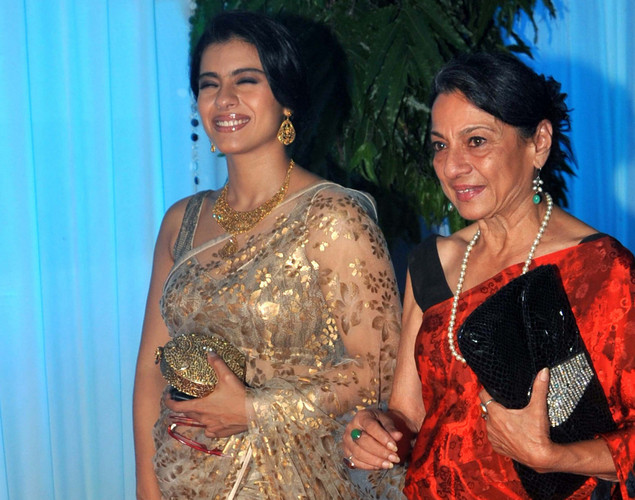Bollywood film actress Kajol (L) and her mother Tanuja Mukherjee pose during the wedding reception of film actress Esha Deol and husband Bharat Takhtani in Mumbai.