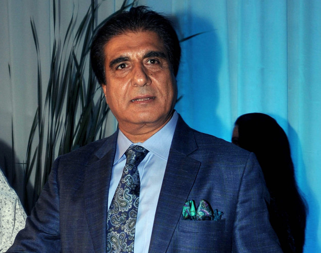 Bollywood film actor Raj Babbar poses during the wedding reception of film actress Esha Deol and husband Bharat Takhtani in Mumbai.