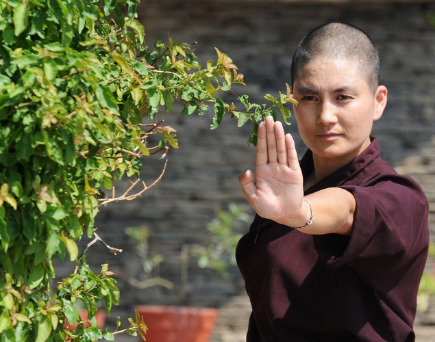 A Buddhist nun practices Kung-fu at the Amitabha Drukpa Nunnery on the outskirts of Kathmandu.