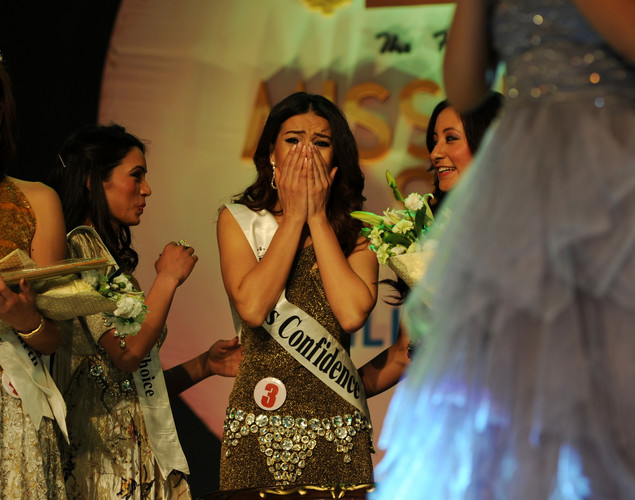 Newly-crowned Miss Nepal Shristi Shrestha (c) gestures after wiining the contest in Kathmandu.