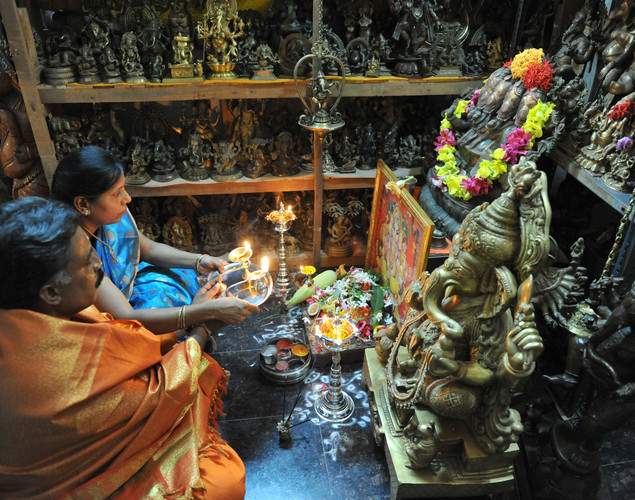 Hindu devotees bring home idols of Lord Ganesha in order to invoke his blessings for wisdom and prosperity, ahead of the eleven-day long Ganesha Festival.