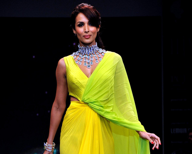 Malaika Arora Khan showcases jewellery designer KGK Entice Jewels creations as she walks the ramp during the fourth day of India International Jewellery Week 2012 (IIJW) in Mumbai on August 22, 2012.