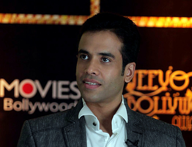 Tusshar Kapoor holds the unseen trophy for the 'Best Actor in a Comic Role at the first 'Jeeyo Bollywood Awards' in Mumbai on May 10, 2011.