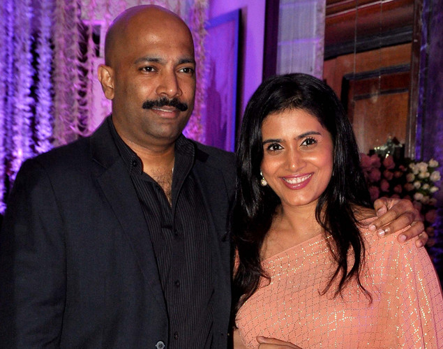 Bollywood actress Sonali Kulkarni (R) with husband Nachiket Pantvaidya attend the wedding reception of playback singer Sunidhi Chauhan and musician Hitesh Sonik.