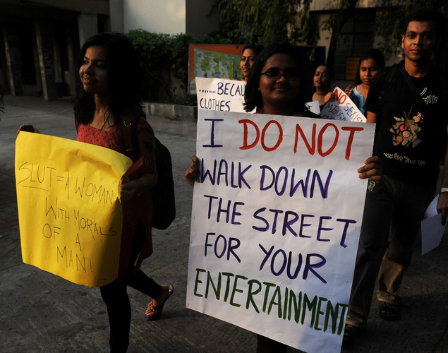 Social activists hold posters during a 'Slut Walk' in Kolkata.
