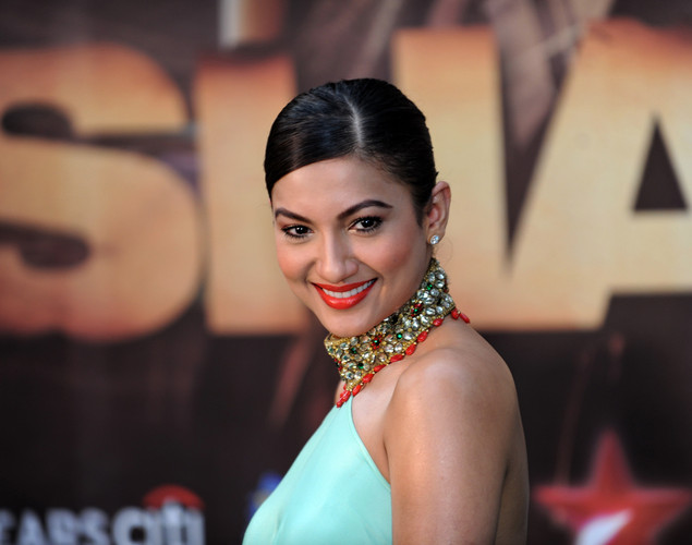 Bollywood actress and model Gauhar Khan poses for the media after arriving at the green carpet to attend the premier of the new movie 'Shanghai' during the International Indian Film Academy (IIFA) awards event, in Singapore.