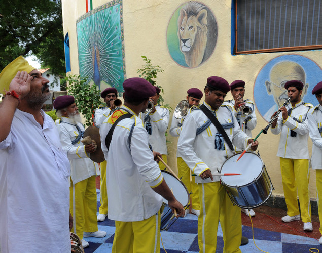 Indian inmates of Sabarmati Central Jail participate in a flag hoisting ceremony to celebrate India's Independence Day at the Sabarmati Central Jail in Ahmedabad on August 15, 2012.