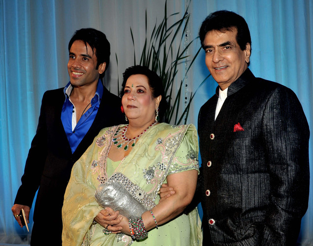 Bollywood film actor Jitendra (L), wife Shobha (C) and son Tushar Kapoor pose during the wedding reception of film actress Esha Deol and husband Bharat Takhtani in Mumbai.