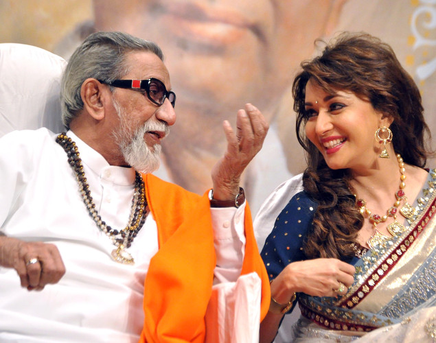 Politician Shiv Sena chief Bal Thackeray (L) and Indian Bollywood film actress Madhuri Dixit Nene attend the 'Deenanath Mangeshkar Puraskar Awards 2012' ceremony in Mumbai.